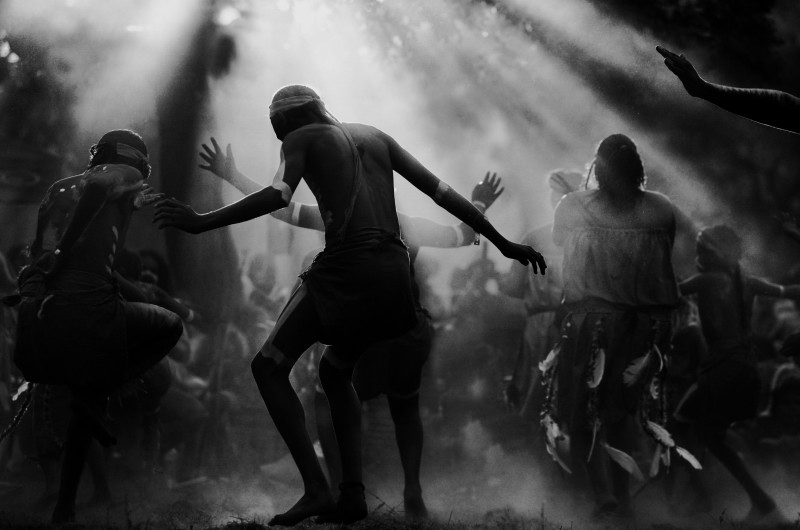 Black and white photo of Indigenous dancers