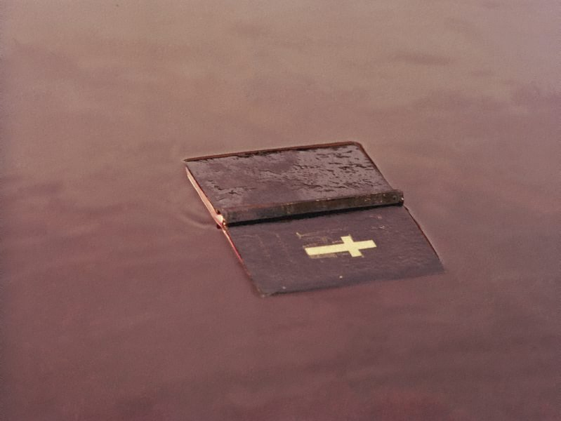 A bible on red earth