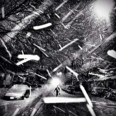 Black and white, walking in the snow. Photographed by Ben Lowy