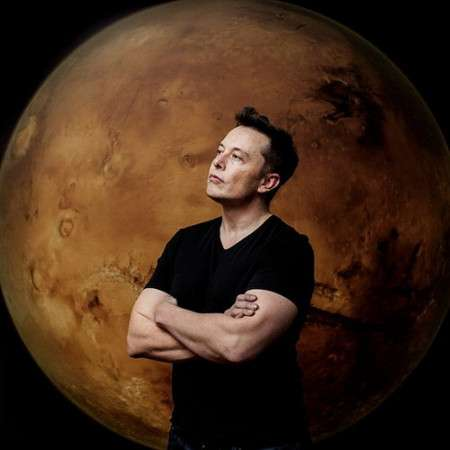 Elon Musk for Fortune Magazine standing in front of a moon. Photographed by Ben Lowy